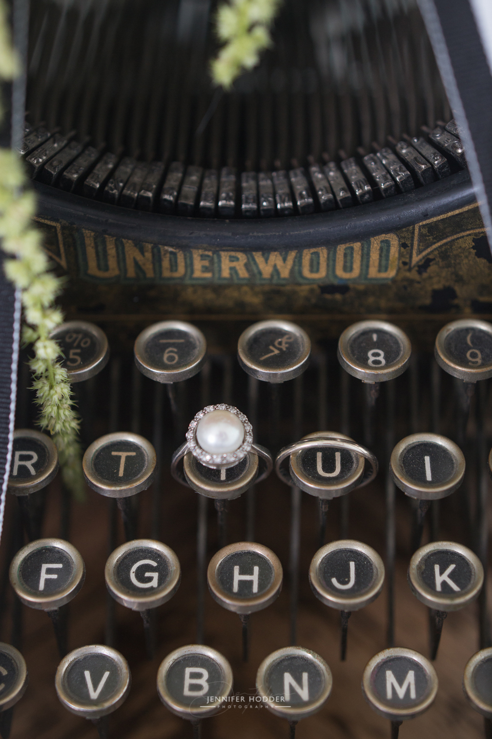 vintage typewriter with pearl engagement wedding ring